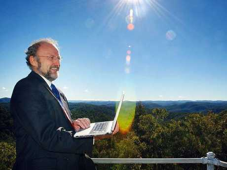Broadband expert Paul Budde with his laptop on top of a mountain at Bucketty. Picture: Peter ClarkSource:News Limited