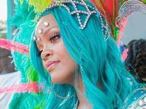 Rihanna sizzles in sexy silver bikini