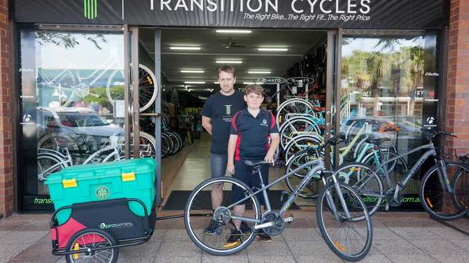 CYCLING FOR SHELTERBOX: Alstonville Public School student Laen Wilkin cycled from Ballina to Byron Bay towing a ShelterBox to raise money for the charity which provides disaster relief internationally. Michael Latimer, from Transition Cycles in Balina, provided the bike.