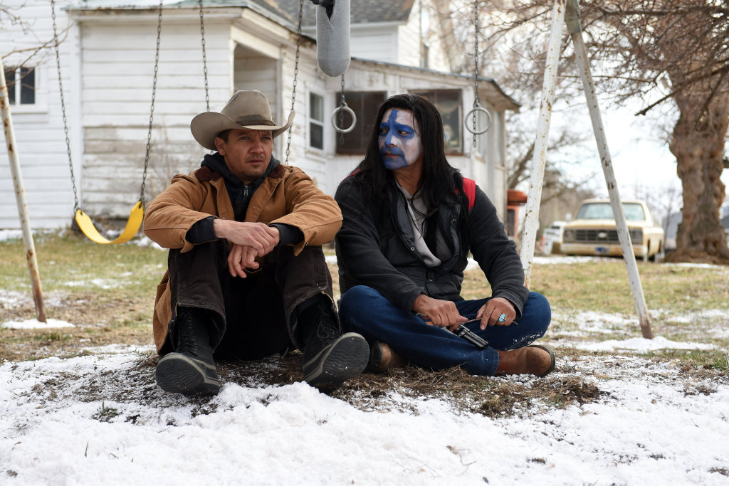 Jeremy Renner and Gil Birmingham in a scene from the movie Wind River.