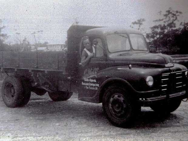 Hall Contracting founder Les Hall in the company's first truck.