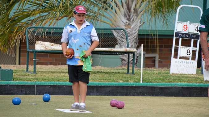 Wyatt Martin lines up a shot during the Men's Pairs Carnival at the Gayndah Bowls Club.