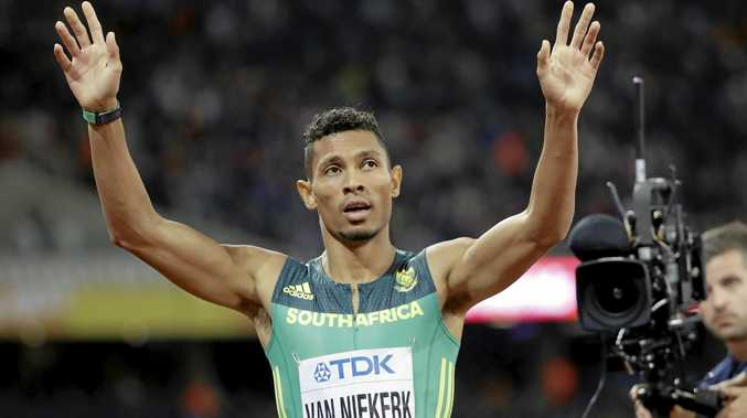 South Africa's Wayde Van Niekerk celebrates winning the gold medal in the Men's 400m final