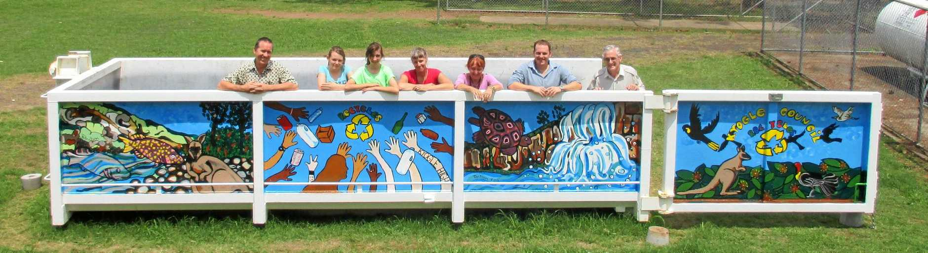 DUMP WASTE LEVY: Kyogle mayor Cr Danielle Mulholland calls on the NSW Premier to dump the waste levy. Here Kyogle High School staff and students join with David Bell and David Bevan of Kyogle Council to admire the new artwork on the recycling skip bin.