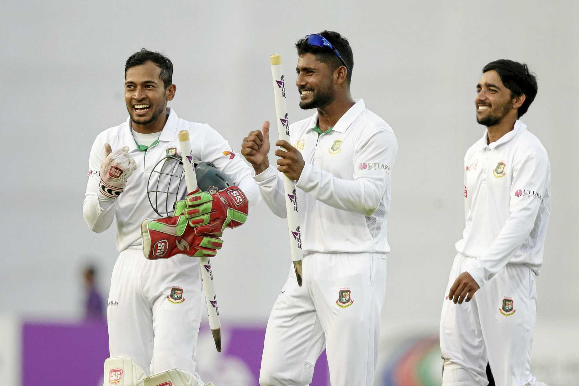 Bangladesh's captain Mushfiqur Rahim, left, celebrates with his teammates Imrul Kayes, centre, and Mominul Haque after their victory over England in October.