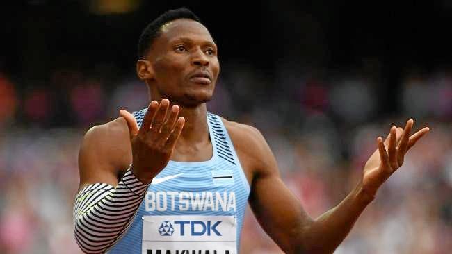 Botswana's Isaac Makwala is prevented from running.