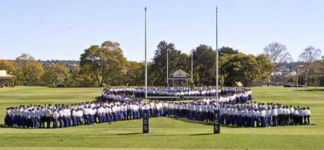 POWER OF PEOPLE:  Toowoomba Grammar students make the shape of a ribbon on the TGS oval for It's a Bloke Thing. Wednesday, 9th Aug, 2017.