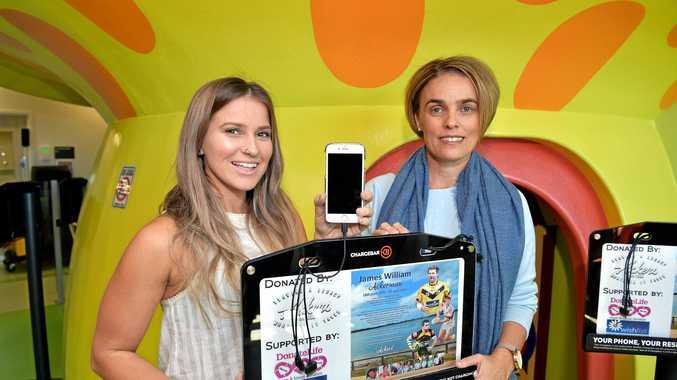 PLEASED: The Ackerman family has donated phone charging stations to the Sunshine Coast University Hospital. Saraa Ackerman and Sonya Ackerman plug into the charger.