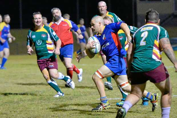 UNSUNG HERO: Gladstone Goats flanker Adam Edminstone on the charge against Frenchville this season.