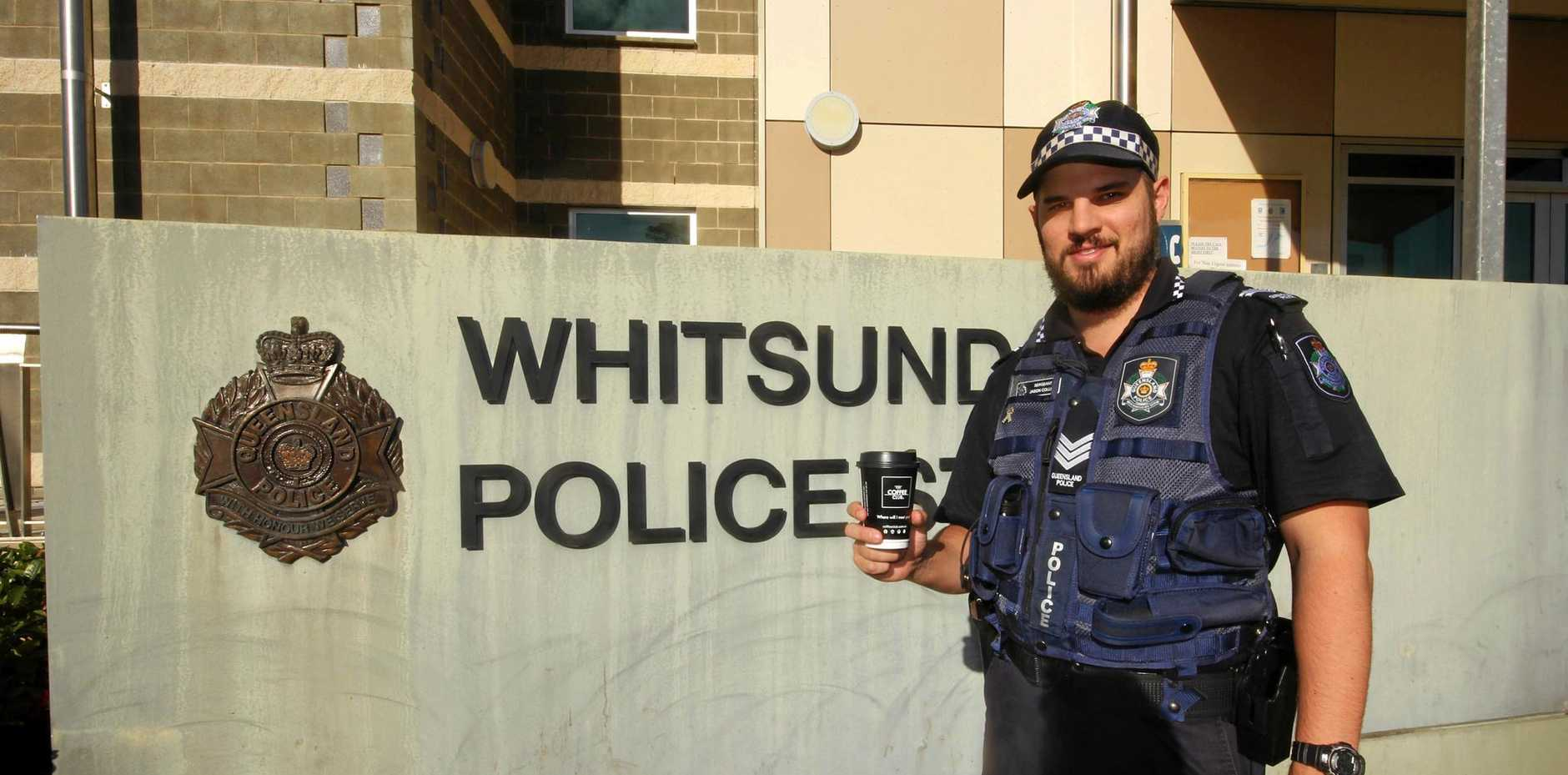 HAVE A CHAT: Sgt Jason Colley with coffee in hand .