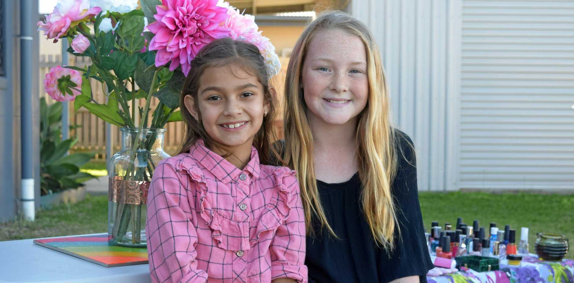 Rose Aujla, 7,with Breeanna Taylor, 11, at their backyard pamper business on Wednesday.