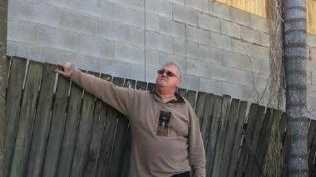 Gary Hughes says he is being overshadowed by a wall built on the boundary of a new development neighbouring his property. Picture: Darren Cartwright