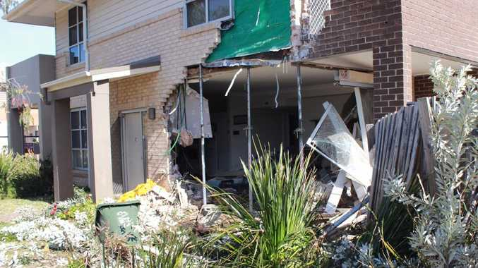 Police are searching for the driver of a truck that crashed into this Kingswood house overnight. Picture: Danielle Jarvis