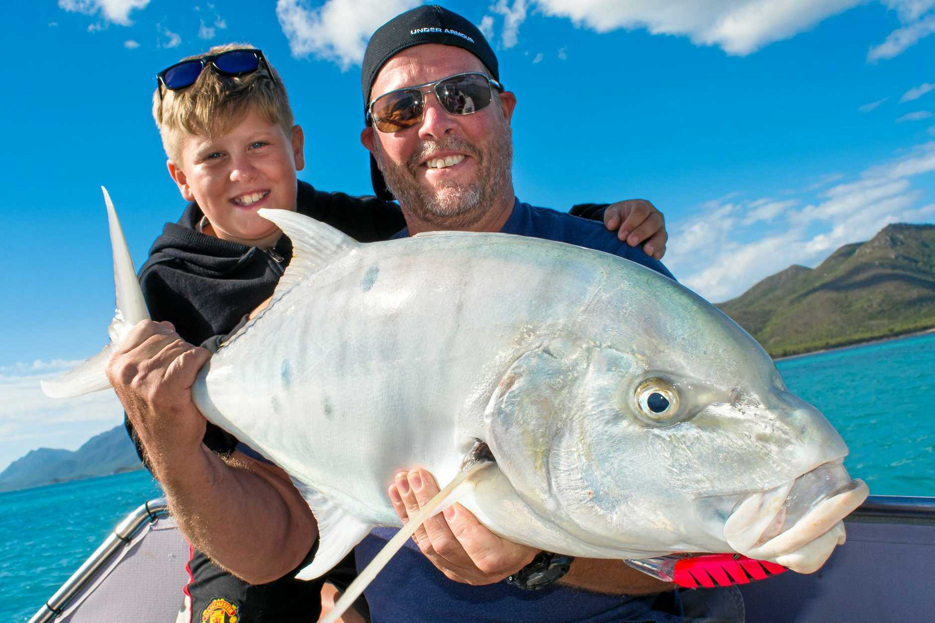 John and Coen Mitchell with a nice golden trevally caught with Reel Addiction Sport Fishing.