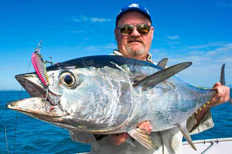 Simon Young with a 15kg longtail tuna landed with Reel Addiction Sport Fishing.