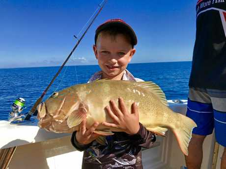 TOP TROUT: Six-year-old Shannon Matthews went to the reef with dad and caught this 69cm coral trout.