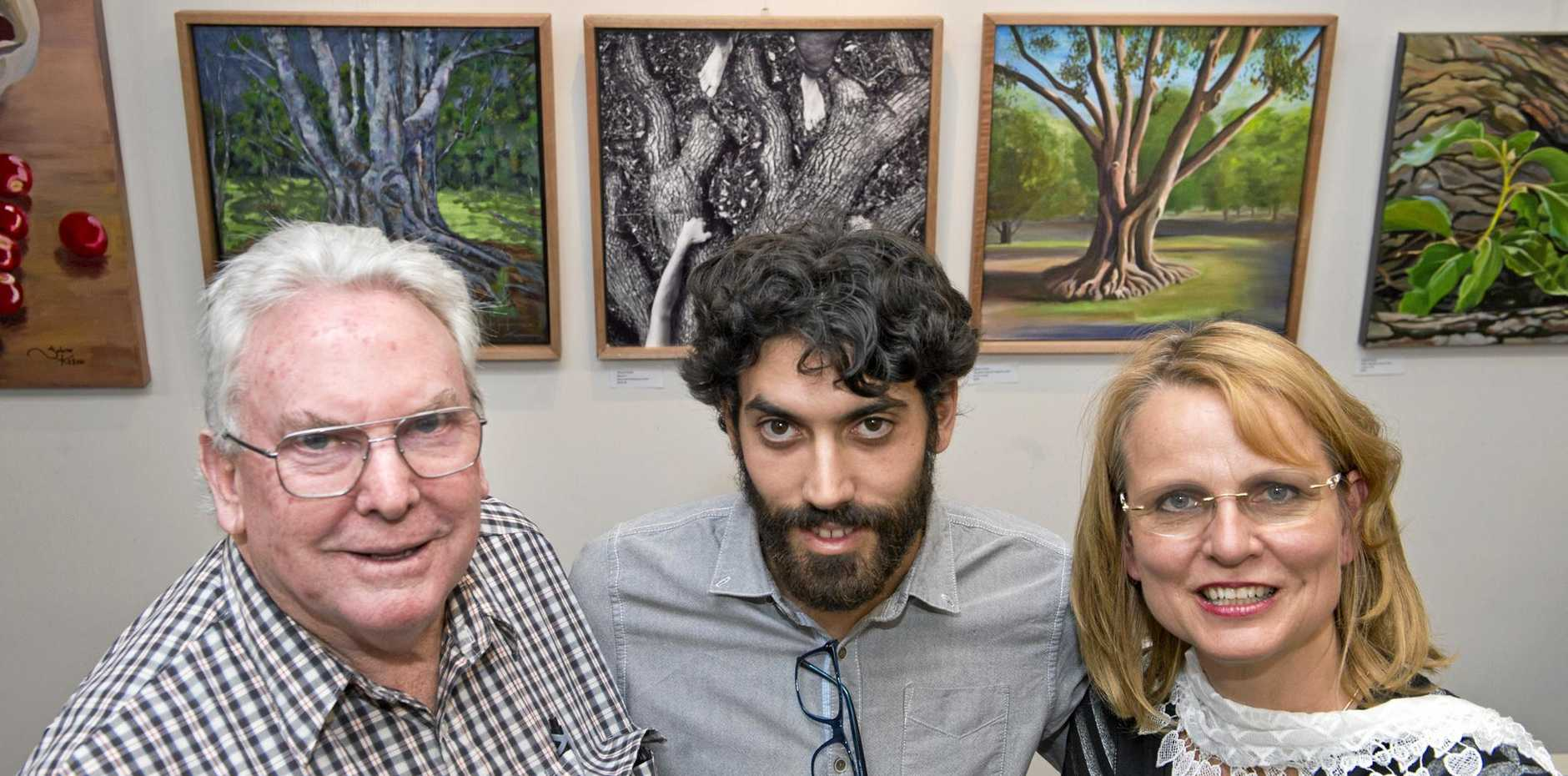 ( From left ) Peter Fitzpatrick, Vincent Parisi and Sabine Kehoe  at Toowoomba Art Society's exhibition