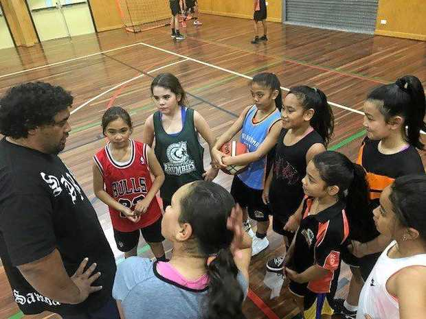 Springfield Brumbies Basketball Club girls training sessions held on Wednesday nights at Woodcrest State College with coach, Tino.