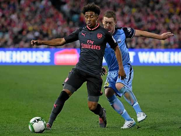 Reiss Nelson of Arsenal competes for possession with Brandon O'Neill of Sydney FC during their friendly in July.