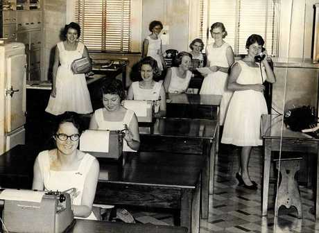 4MB staff from 1960 (seated front-back) Val Coleman, Faye Thacker, Pat Roberts, Anne Hesselwood, Colleen Lobegeier, (standing left-right) Carolyn Whitby, Gaye O'Brien, Wendy Daniel, and Thelma Kearle.