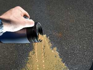 Man cops $450 fine for pouring coffee on ground