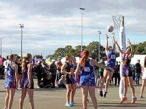 Netball finals action heats up in Warwick