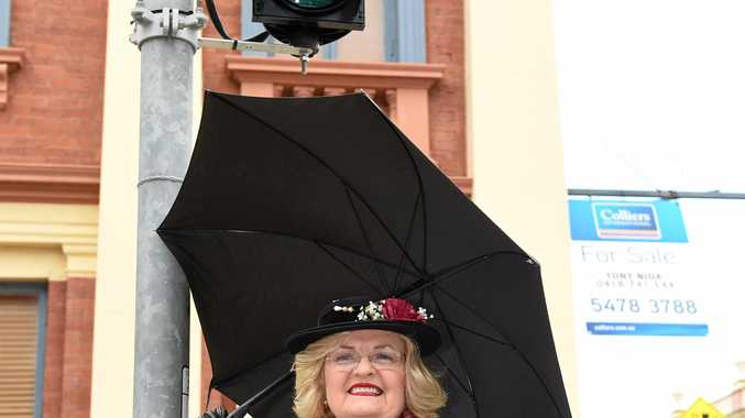 Mary Poppins at the newly installed pedestrian traffic lights at Kent and Richmond Sts in Maryborough.