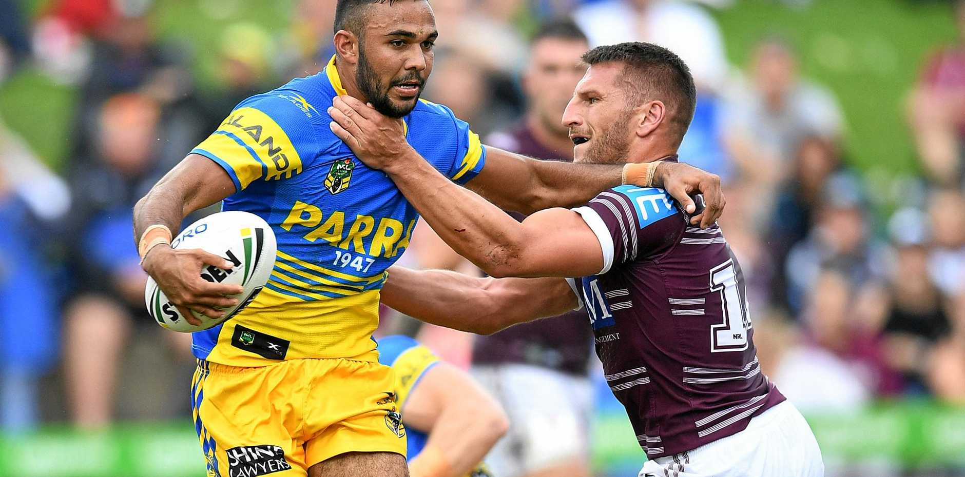 Bevan French of the Eels is tackled by Lewis Brown of the Sea Eagles.