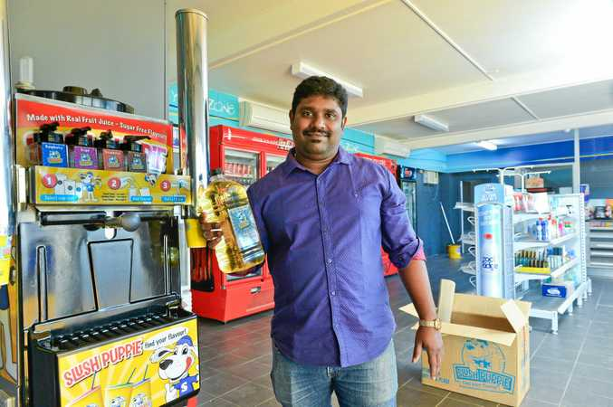 PUMPED: Anidas Bhanudas is pumped up about re-opening the Toolooa Street service station.The vintage Slush Puppie machine will be a feature inside.