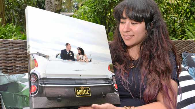 Carmela Xiriha Springer with her and Daniel's wedding photo. Together for 12 years, they have an 11-month-old son named Wolf.
