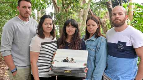 GRIEVING: Daniel Springer's widow, Carmela Xiriha Springer (centre), and (from left) Zach Rodda, Maria Xiriha,  Tarah Rodda and David Miller remember the 31-year-old who died after a workplace accident at the weekend.