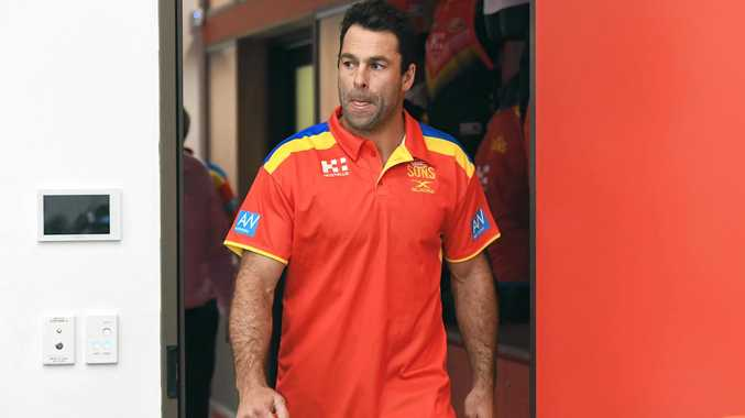 Interim Gold Coast Suns coach Dean Solomon arrives for his first press conference at Metricon Stadium.