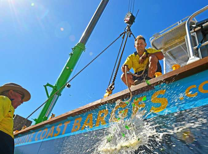 SETTING SAIL: Sunshine Coast Barges co-owners Ian Michael and Oliver Fink christen their new barge Hollie.