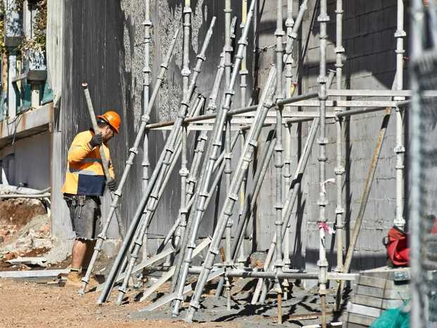 Scaffolding is erected on a building site.