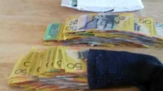 Cash seized in raids.