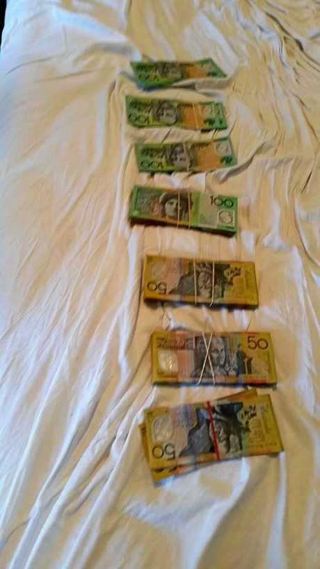 Cash seized in raid.