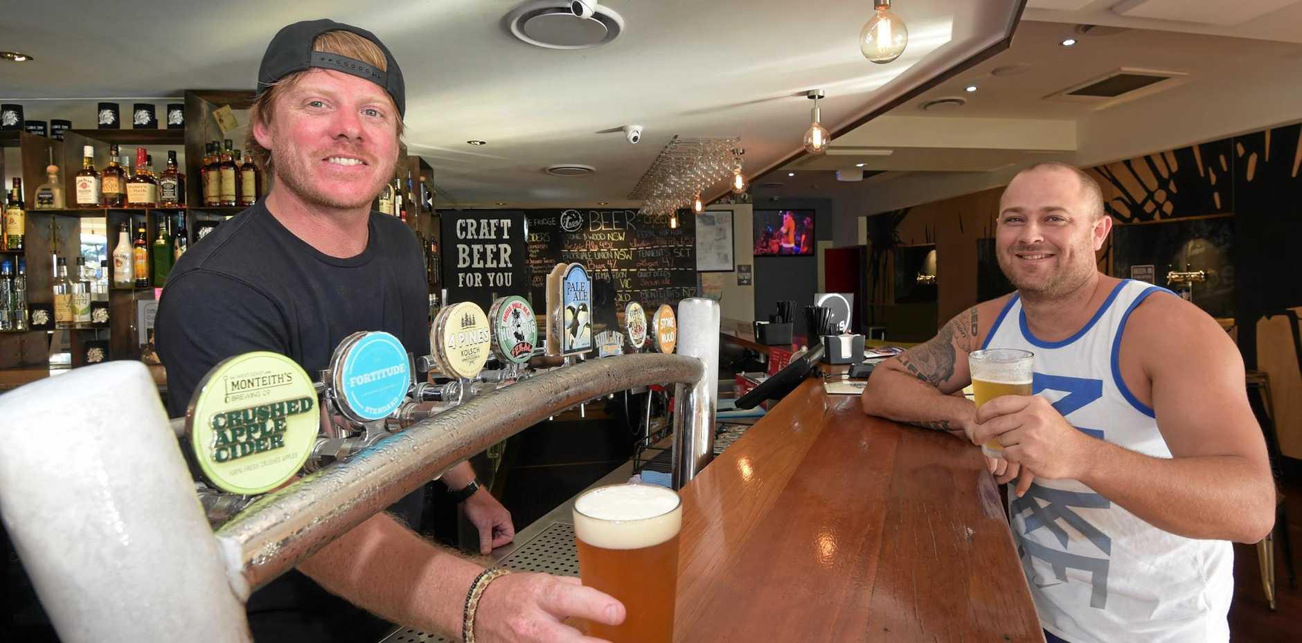 Owner of Taps Mooloolaba, Steve Barber, serves up a craft beer. Photo: Brett Wortman / Sunshine Coast Daily