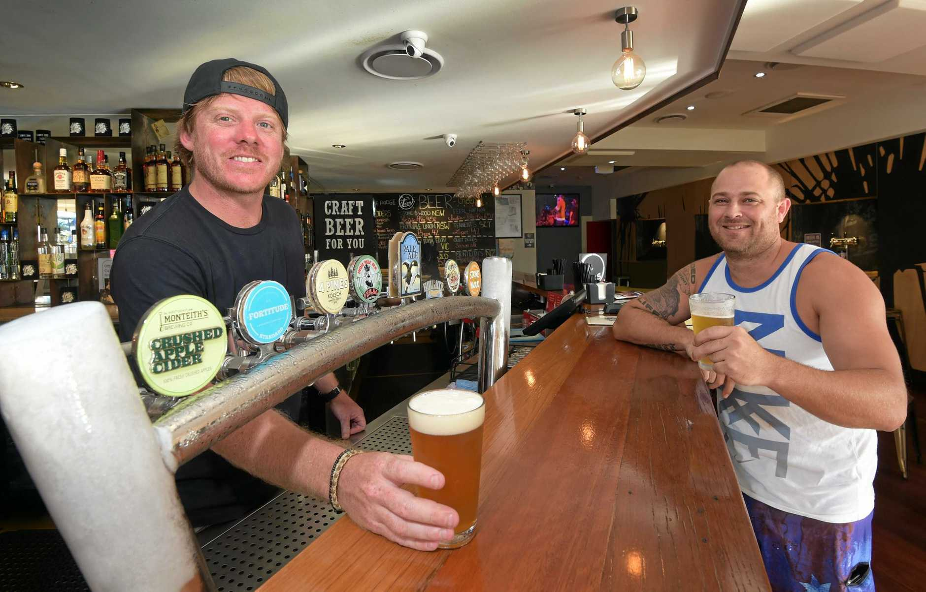 Owner of Taps Mooloolaba, Steve Barber, serves up a craft beer. Photo: Brett Wortman / Sunshine Coast Daily