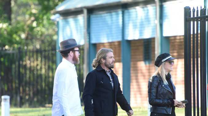 Xavier Rudd, centre, fronting Byron Bay Local Court this morning.