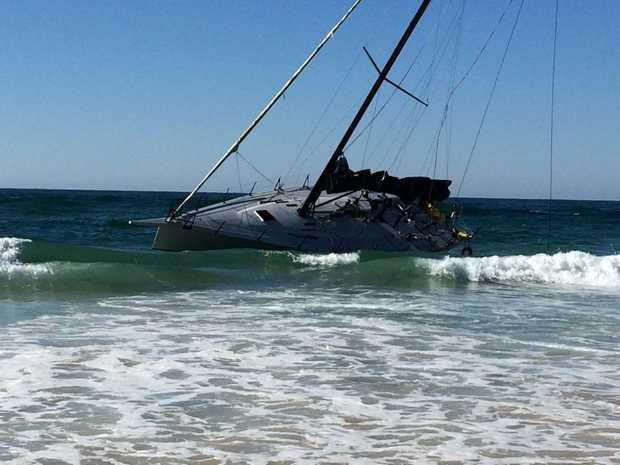 Stricken yacht on Kings Beach, Broken Head.