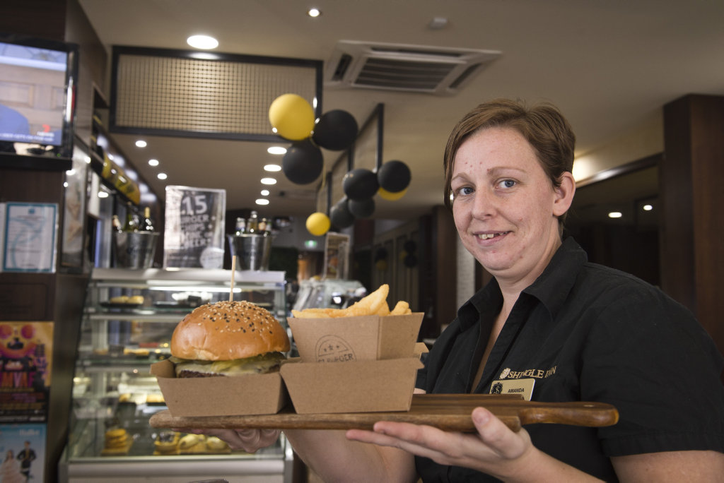 Amanda Lloyd with a St Burger as part of the Burger Bonaza introductory offer, Friday, August 11, 2017.