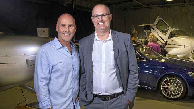 Enjoying the wares of Cirrus Aircraft and Mercedes-AMG is Grant Kenny (left) and dealer principal Cameron O'Hara.