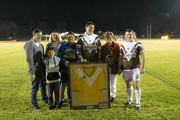 MEMORABLE HISTORY: Justin, Calen, Kayla, Saylor, Heta and Anne Heke with Joel Duffy (Coach) presenting the framed 1983 jersey.
