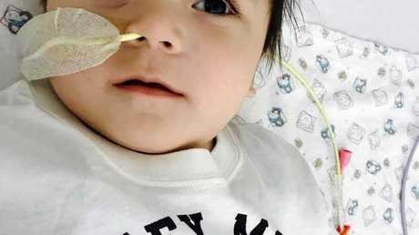 LUCKY LITTLE BOY: Logan Prouwer, 10-months-old, suffered a severe brain aneurysm last March but against all odds has managed to pull through.