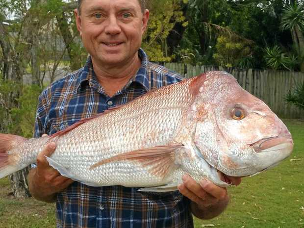 SOLID CATCH: Eric Frei with a monster 90cm snapper from his favourite northern reef.