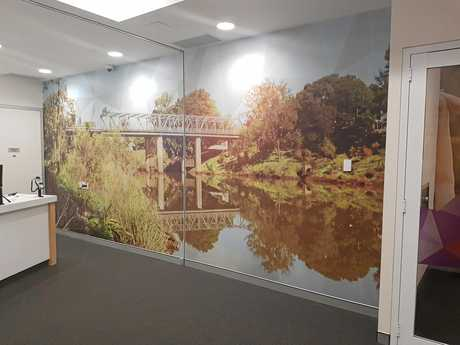 The water line in the picture is at exactly 1.3 metres above the floor, which is the height the water came into the branch. The River picture will remain as a subtle but permanent reminder of the 2017 floods.