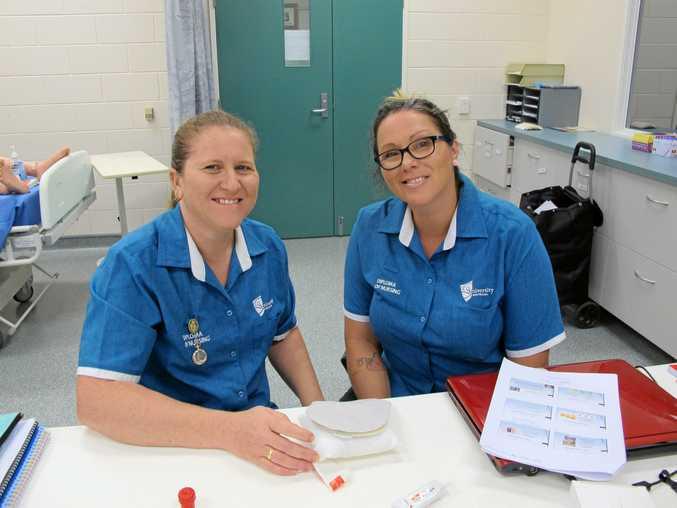 STUDY TIME: Bundaberg Diploma of Nursing students Mandi Dawson and Bella Lee on campus.
