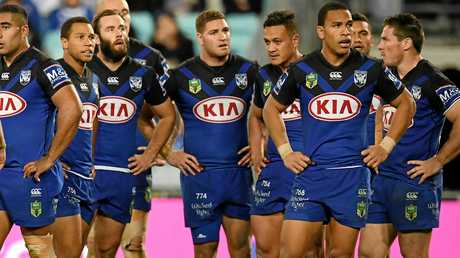 The Bulldogs look dejected after Alex Johnston of the Rabbitohs scored one of his two tries.