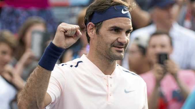 Roger Federer of Switzerland celebrates his 4-6 6-4 6-2 victory over David Ferrer of Spain at the Rogers Cup in Montreal.