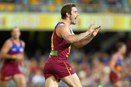 Ryan Bastinac of the Lions celebrates a goal during the round 20 match against the Western Bulldogs at the Gabba.